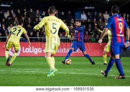 VILLARREAL, SPAIN - JANUARY 8: Pique with ball during La Liga soccer match between Villarreal CF and FC Barcelona at Estadio de la Ceramica on January 8, 2016 in Villarreal, Spain