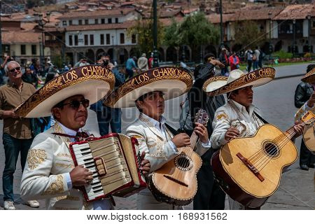 CUSCO PERU - OCTOBER 7 2016: Latin musicians in sombrero play guitars and accordion in a wedding