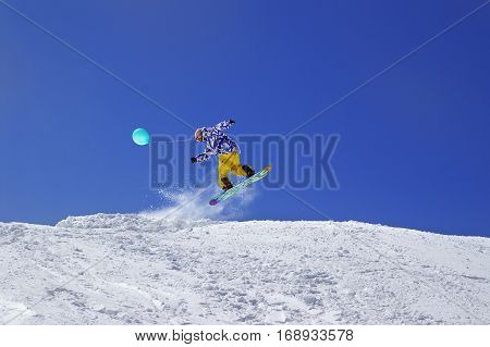 Snowboarder Jump With Toy Balloon In Terrain Park At Ski Resort On Sun Winter Day