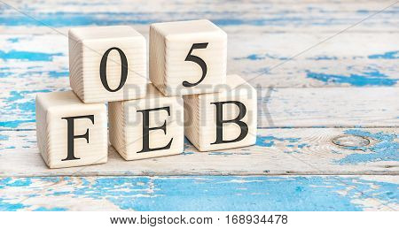 February 5Th. Wooden Cubes With Date Of 5 February On Old Blue Wooden Background.