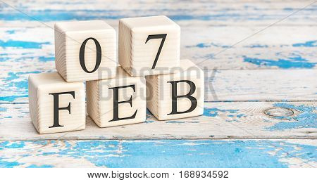 February 7Th. Wooden Cubes With Date Of 7 February On Old Blue Wooden Background.