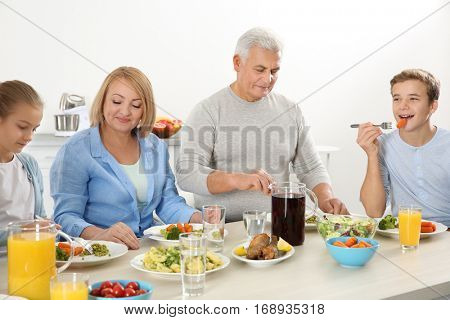 Happy family having lunch in kitchen