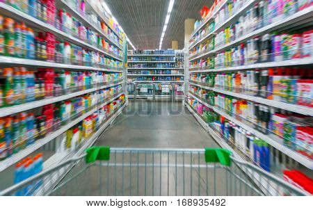 Shopping Cart View on a Supermarket Aisle and Shelves - Image Has a Shallow Depth of Field