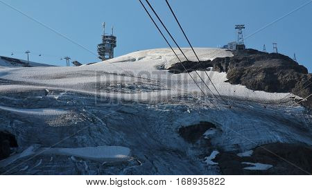 Scene on the way to the top of mount Titlis Switzerland. Glacier and cables of the mount Titlis cable car.