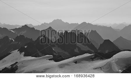 Rugged mountain ranges in Switzerland. View from mount Titlis towards mount Oberalpstock. Many peaks.