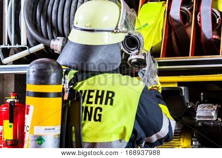 Fire fighter with breathing protection and oxygen tank