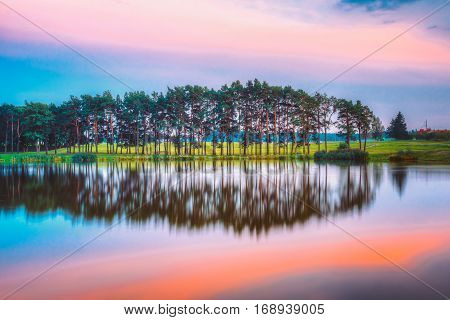 Water Surface Of Lake Pond River At Summer Sunny Evening. Nature Of Belarus And European Part Of Russia. Copyspace. Forest Landscape At Another Side Of River