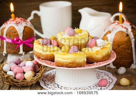 Traditional Easter treats - Easter cake kulich Easter nest cakes Easter candy eggs