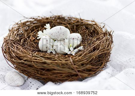Easter eggs in nest - bird nest with chocolate candy mini eggs decor idea and treats on Easter holidays