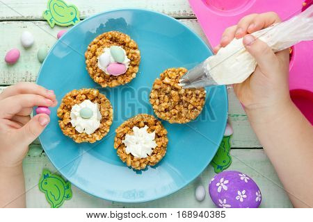 Easter nest cookie cake dessert with candy eggs and whipped cream cooking Easter recipe step by step