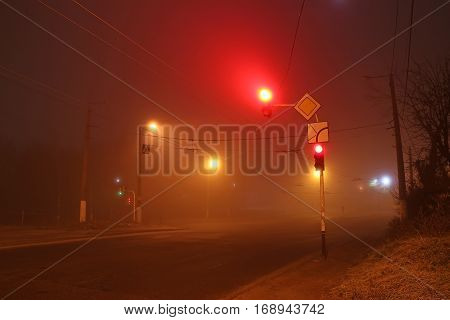 scary traffic light in the fog at night