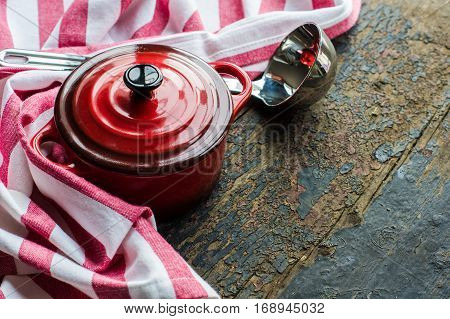 Cooking Pot On Rustic Background