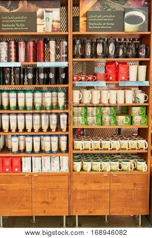 DUBAI - CIRCA NOVEMBER, 2016: shelves with cups at a Starbucks cafe in Dubai International Airport. Starbucks Corporation is an American coffee company and coffeehouse chain.