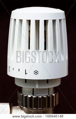 Thermostatic radiator valve set to minimal temperature for saving