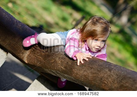 Toddler Climbing On The Walk