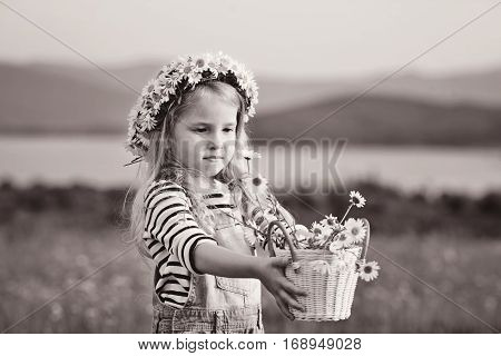 girl with daisies in basket and on the head