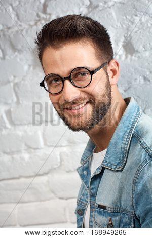 Portrait of smart young caucasian man in eyewear.