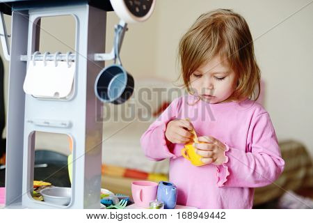 Toddler  Playing With Kitchen