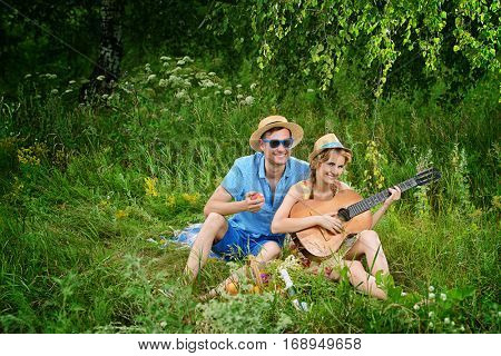 Beautiful young people in love enjoy their summer picnic.
