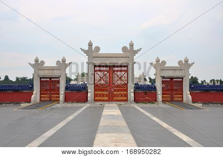 Archway Gates to the Round Altar (Circular Mound Altar) in Temple of Heaven, Beijing, China. Temple of Heaven: an Imperial Sacrificial Altar in Beijing is UNESCO World Heritage Site since 1998.