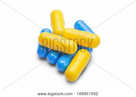Medicine Yellow And Blue Pills On A Isolated White Background