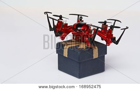 Drone with gift box isolated on white background. Shipping fly drone delivery concept