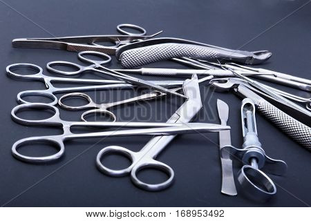 Surgical instruments and tools on table for a surgery.