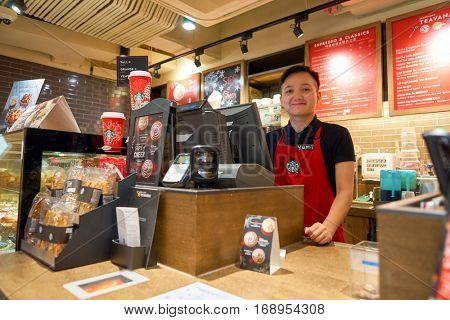 HONG KONG - CIRCA NOVEMBER, 2016: staff at a Starbucks cafe in Hong Kong. Starbucks Corporation is an American coffee company and coffeehouse chain.