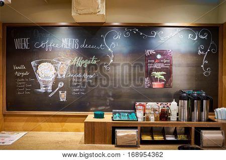 HONG KONG - CIRCA NOVEMBER, 2016: blackboard at a Starbucks cafe in Hong Kong. Starbucks Corporation is an American coffee company and coffeehouse chain.