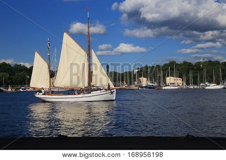 STOCKHOLM, SWEDEN - JUNE 27, 2016: Sailboat are sailing between the islands of the city.