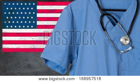 Blue doctor scrubs shirt and stethoscope hang empty in front of USA flag. Illustration of healthcare system needing immigrants to help with staffing issues