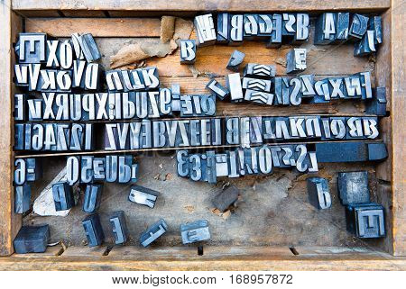 old steel fonts in wooden case many letters