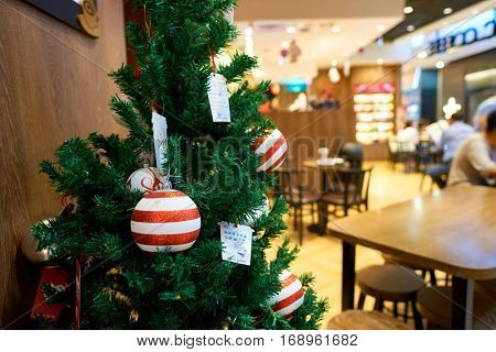 HONG KONG - CIRCA NOVEMBER, 2016: Christmas decorations at a Pacific Coffee branch in Hong Kong. Pacific Coffee Company is a Pacific Northwest U.S.- style coffee shop group originating from Hong Kong.