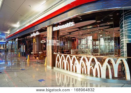 DUBAI, UAE - CIRCA NOVEMBER, 2016: a McDonald's restaurant at Dubai International Airport. McDonald's is an American hamburger and fast food restaurant chain.