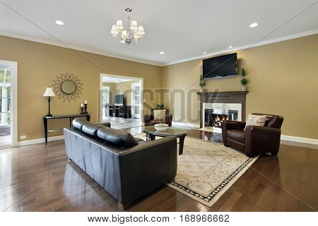 Family room in upscale home with fireplace.