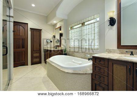 Master bathroom in luxury home with bathtub