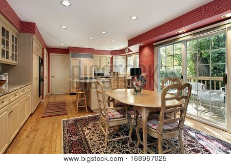 Kitchen with eating area and sliding door to deck.