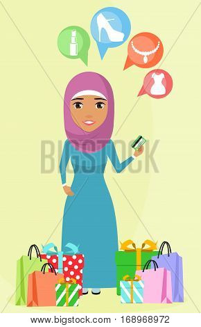 Young girl standing near shopping bags and boxes in a gift box. Arab girl. Girl holding a credit card in her hand. Happy girl.