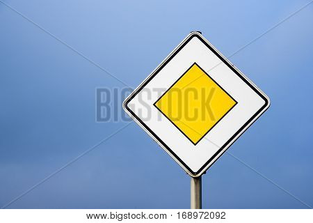 Priority road european traffic sign against the clear blue sky copy space