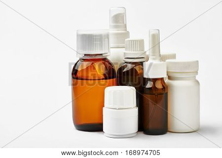Set of remedy bottles isolated. Liquid medicine and pill containers. Prescription for drugs.