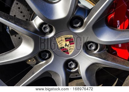 Indianapolis - Circa February 2017: Traditional Porsche Wheel Logo on a new 911. Porsche Racing Dates to the 1950s V