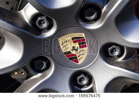 Indianapolis - Circa February 2017: Traditional Porsche Wheel Logo on a new 911. Porsche Racing Dates to the 1950s IV