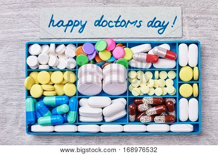 Box with pills. Surprise for Doctor's Day.