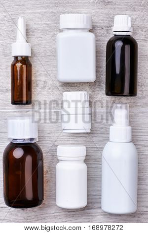 Set of remedy bottles. Glass vials and pill containers. Prescription for medicines.