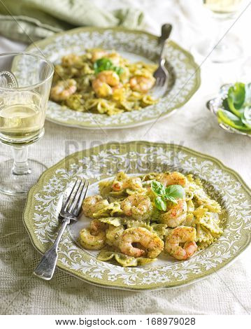 Delicious home made farfalle pasta with shrimp and basil pesto.