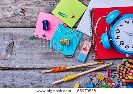 Notebook, pencils and clamps. Stationery for your office.