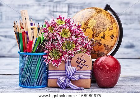 Box, flowers, globe and stationery. Present to teacher's Day.