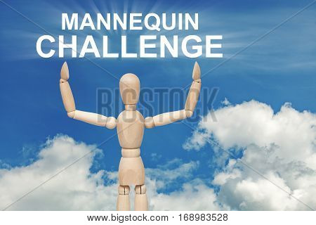 Wooden dummy puppet on sky background with words MANNEQUIN CHALLENGE. Abstract conceptual image