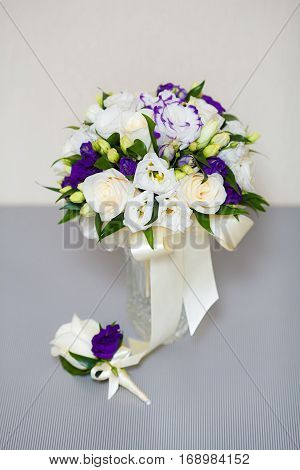 Close up of beautiful bridal wedding bouquet and boutonniere