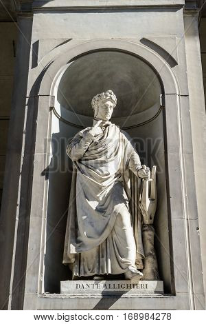 The Dante Alighieri statue in the uffizi courtyard
